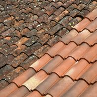 Old and new terracotta rooftiles on a French roof.Similar image: